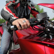 Hand of motorcyclist  on country road — Stock Photo