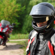 Motorcyclist and his bike on country road — ストック写真