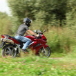 Motorcyclist riding on country road — Stock Photo