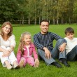 Happy family of four persons outdoors — Stock Photo #7429589
