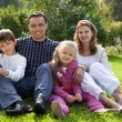Happy family of four persons outdoors - Stock Photo