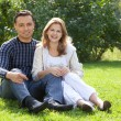 Man and woman in braces laughing outdoors - Stockfoto