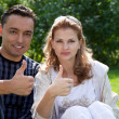 Married couple with their thumbs up — Stock Photo