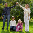 Parents hand by hand with children - Stockfoto