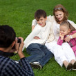 Man photographes his family outdoors — Stock Photo