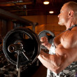 Bodybuilder in training room — Stock Photo #7429655