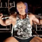 Bodybuilder in training room — Stock Photo #7429666