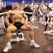 Bodybuilder rests in training room — Stock Photo #7429680