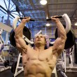 Stock Photo: Bodybuilder doing weightlifting in gym