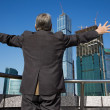 Behind Senior man at the building with hand up — Stockfoto