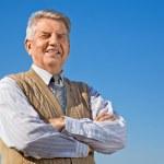 Senior man on background sky — Stock Photo #7429725