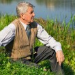 Senior man by the river — Stock Photo