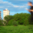 Motion blur man running in park and two buildings - Stock Photo