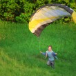Boy and parachute - Stock Photo