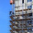 Building in scaffolds - Stock Photo