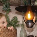 Baby in busket, baby bird on Burning kerosine lamp collage — Stock Photo