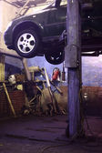 Car on lift in workshop — Stock Photo