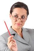 Business woman holding pancil — Stock Photo