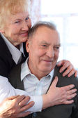 Portrait of elderly pair — Stock Photo