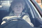 Elderly woman in car — Stock Photo