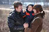 Parents with child on hands — Стоковое фото