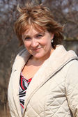 Smiling middleaged woman outdoor — Stock Photo