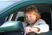 Middleaged woman in car — Stock Photo