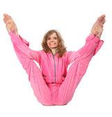Děvče v růžových šatech dělá gymnastických cvičení — Stock fotografie