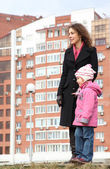 Mother with child and new building — Stock Photo