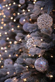 Christmas decorations and lights on New Year tree — Stock Photo