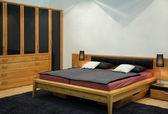 Wooden bedroom — Stock Photo
