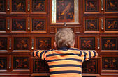 Luxury wooden case with inlaid boxes and boy from back — Stock Photo