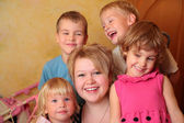Young girl and four children — Stock Photo