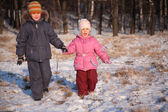 Brother and sister in wood in winter — Stock Photo