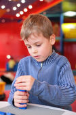 Boy plays with plastic constructor in kindergarten — Stock Photo