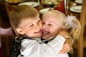 Children embrace on holiday in kindergarten — Stock Photo