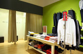 Interior of shop of clothes with fitting rooms — Stock Photo