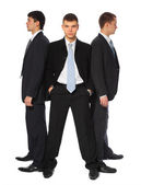 Three young businessmen stand semicircle — Stock Photo