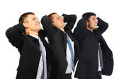 Three businessmen hold hands behind head and look upwards, view — Foto de Stock