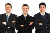 Three laughing businessmen with croosed hands — Stock Photo