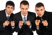 Three businessmen point fingers at you — Stock Photo