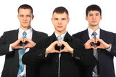 Three young businessmen show love sign from hands — Stock Photo