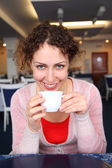 Young woman with cup in cafe — Stock Photo