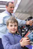 Boy with elderly man in shop of electrotools — Stock Photo