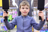 Boy in shop on sports exerciser — Stock Photo