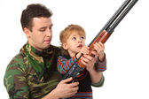 Father and son with gun — Stock Photo