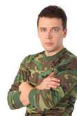 Man in camouflage with crossed hands — Stock Photo