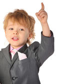 Boy in suit with rised finger — Stock Photo