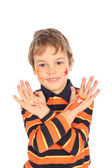 Boy with painted crossed hands — Stock Photo