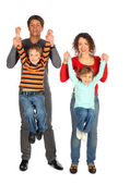 Parents hold children from hands — Stock Photo